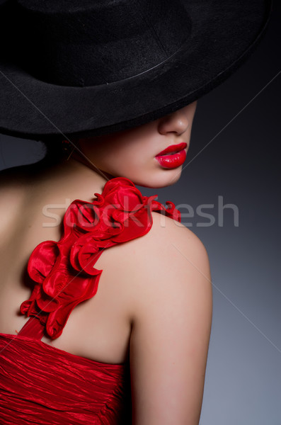 Attractive girl in red dress Stock photo © Elnur