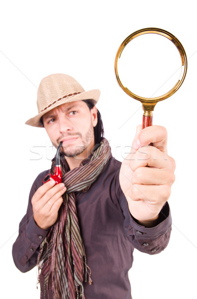Young detective with pipe and magnifying glass Stock photo © Elnur