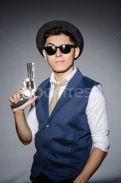 Hombre gafas de sol arma mano funny Foto stock © Elnur