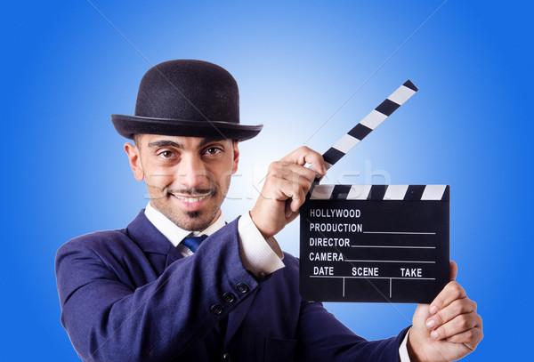 Man with movie clapper against the gradient  Stock photo © Elnur