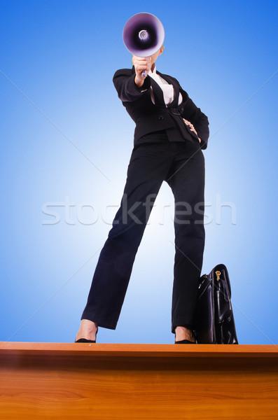Businesswoman shouting through loudspeaker Stock photo © Elnur
