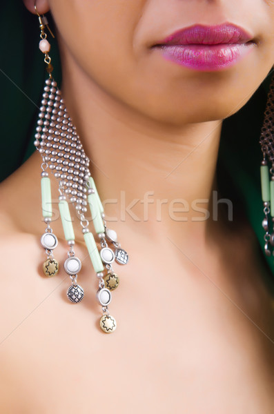 Woman showing off her earrings Stock photo © Elnur