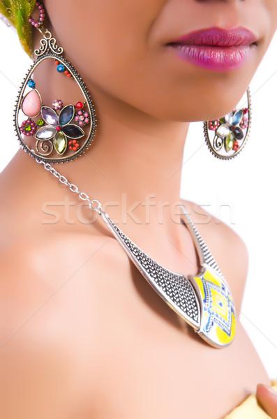 Nő mutat el fülbevalók háttér szépség Stock fotó © Elnur
