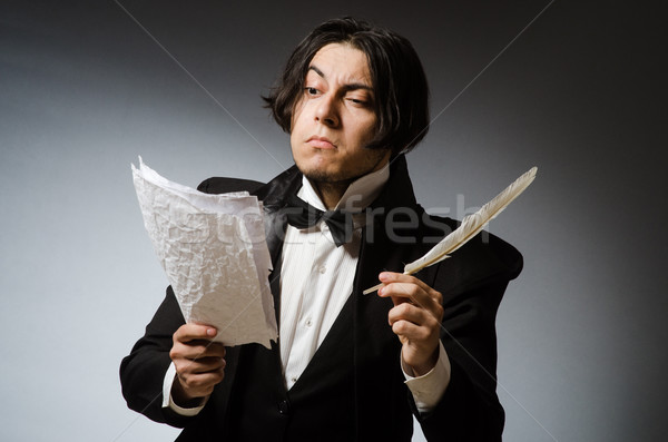 Funny writer with quill in vintage concept Stock photo © Elnur