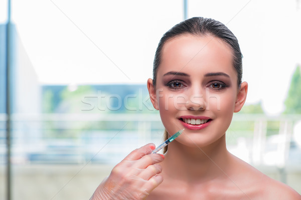 The beautiful woman preparing for botox injection Stock photo © Elnur