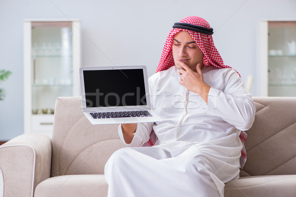 Arab businessman working sitting at couch Stock photo © Elnur