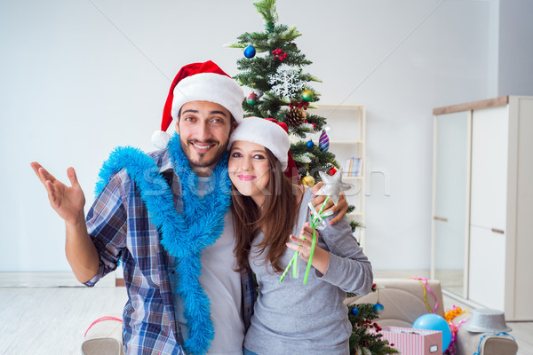 Young family decorating christmas tree on happy occasion Stock photo © Elnur