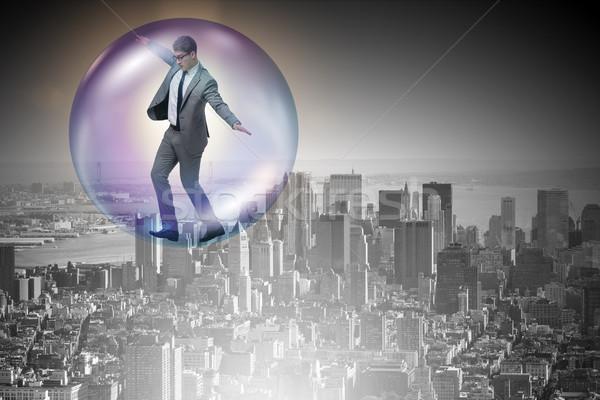 Empresário voador dentro bolha negócio dinheiro Foto stock © Elnur
