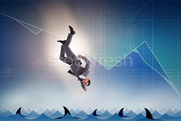 The businessman falling into sea with sharks Stock photo © Elnur