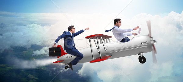 The businessman flying on vintage old airplane Stock photo © Elnur