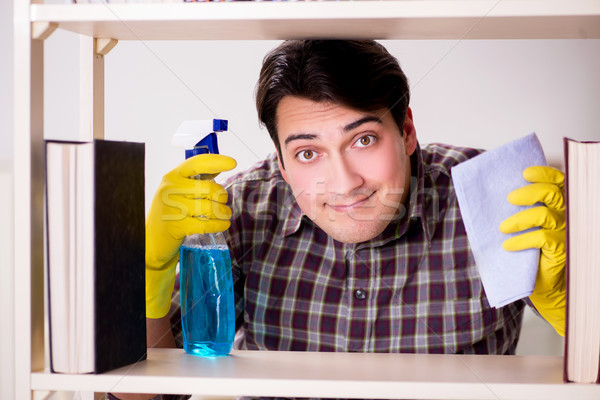 The man cleaning dust from bookshelf Stock photo © Elnur