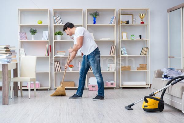 Homme nettoyage maison outils travail meubles Photo stock © Elnur