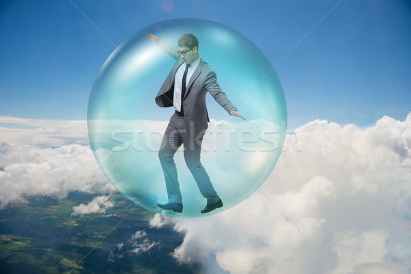 Businessman flying inside the bubble Stock photo © Elnur
