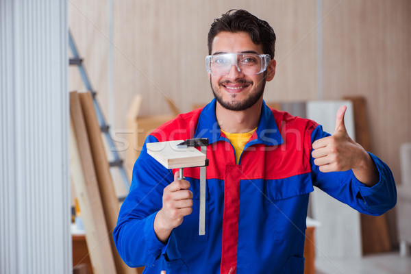 Yooung repairman carpenter working with paint painting Stock photo © Elnur
