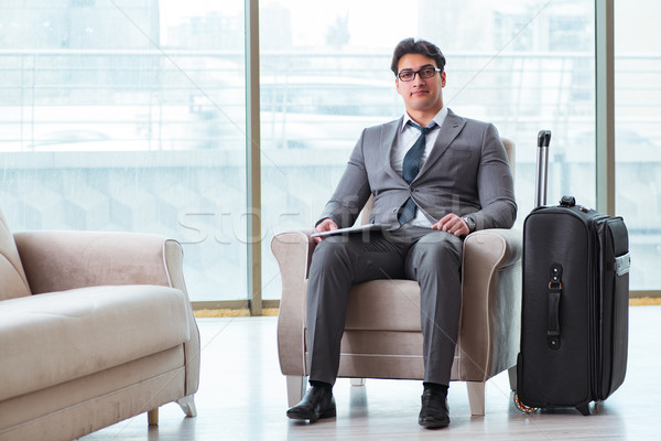 Young businessman in airport business lounge waiting for flight Stock photo © Elnur