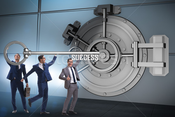 Businessman with key near bank vault door Stock photo © Elnur