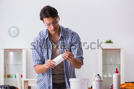 Stock photo: Young man in woodworking hobby concept