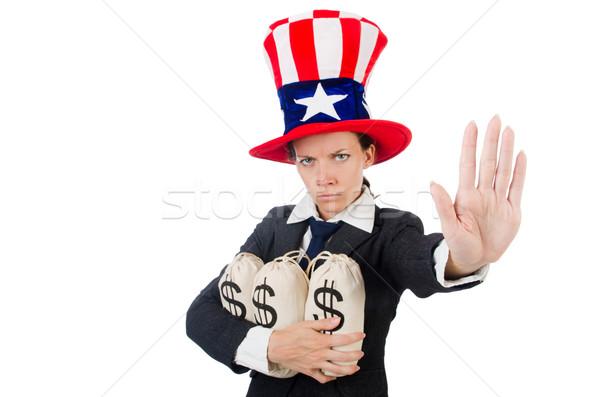 Businesswoman with sacks of money on white Stock photo © Elnur