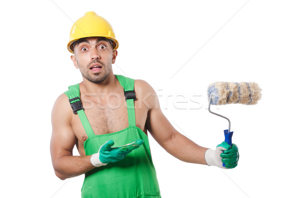 Painter in green coveralls on white Stock photo © Elnur