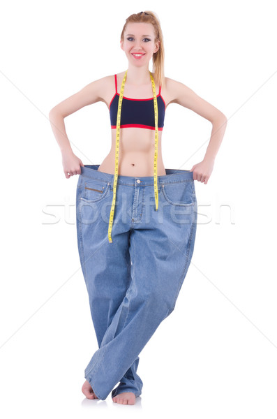 Dieting concept with oversize jeans Stock photo © Elnur
