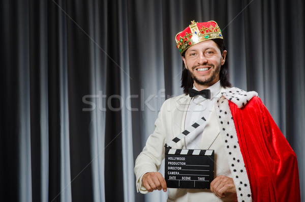 King with movie board in funny concept Stock photo © Elnur