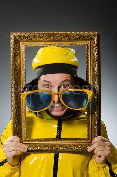 человека желтый костюм фоторамка вечеринка Сток-фото © Elnur