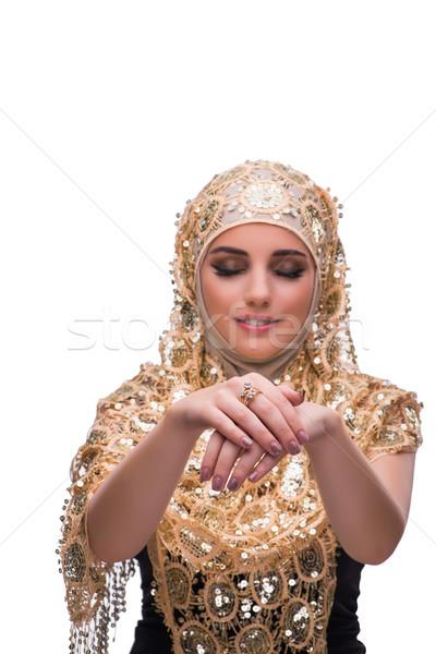 Musulmanes mujer oro cubrir aislado blanco Foto stock © Elnur