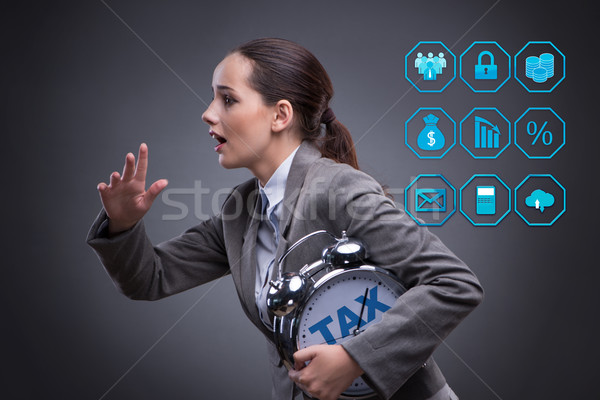 Businessman in late taxes payment concept Stock photo © Elnur