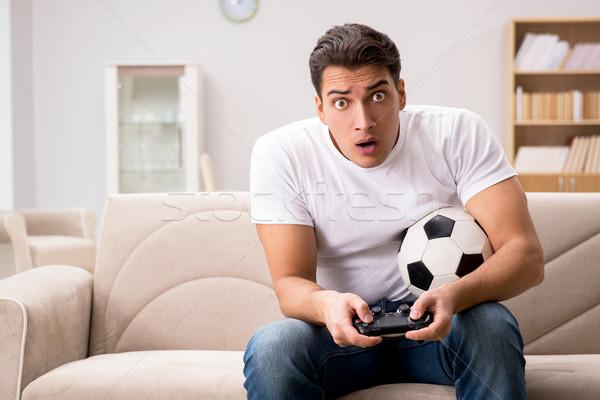 Сток-фото: человека · компьютер · играх · домой · футбола · контроля