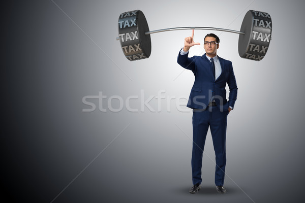 Businessman under  heavy burden of taxes Stock photo © Elnur