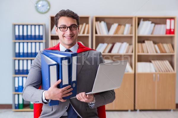 Superhero businessman working in the office Stock photo © Elnur