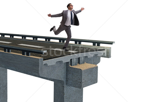 Young businessman with broken bridge isolated on white Stock photo © Elnur