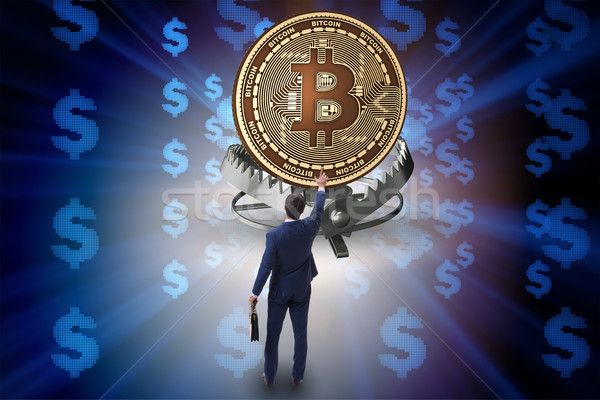 Businessman falling into the trap of bitcoin cryptocurrency Stock photo © Elnur