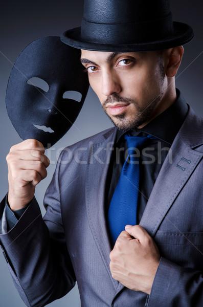 Man with black mask in studio Stock photo © Elnur