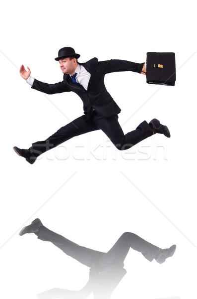 Funny businessman jumping on white Stock photo © Elnur