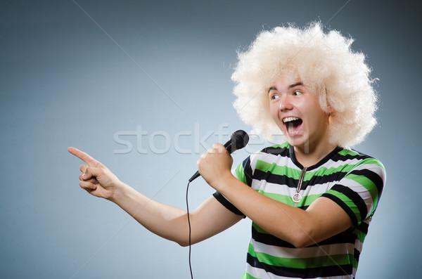 Férfi énekel buli boldog háttér mikrofon Stock fotó © Elnur