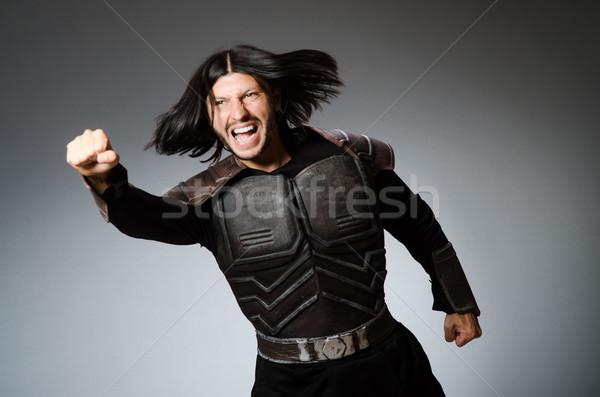 Zangado guerreiro escuro homem terno diversão Foto stock © Elnur