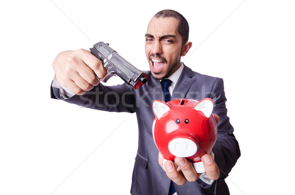 Businessman killing the piggy bank Stock photo © Elnur