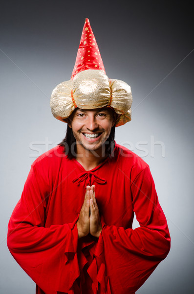 Stock photo: Funny wizard wearing red dress