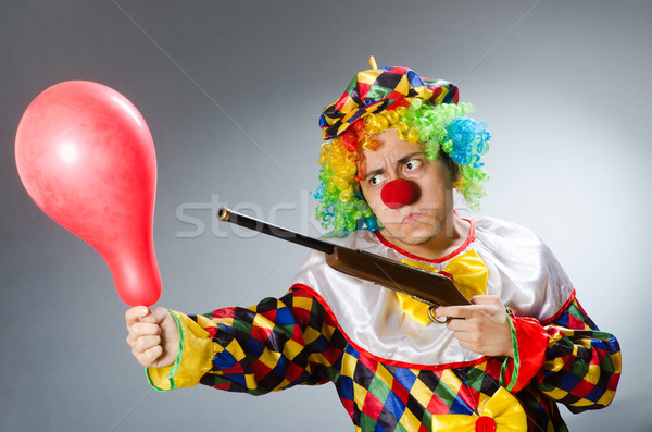 Clown with balloon and rifle in funny concept Stock photo © Elnur