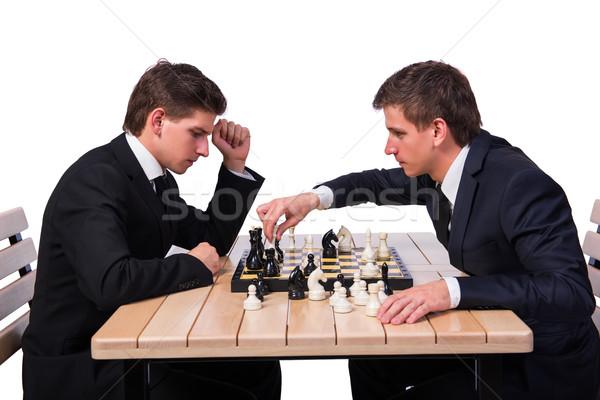 Tweeling broers spelen schaken geïsoleerd witte Stockfoto © Elnur