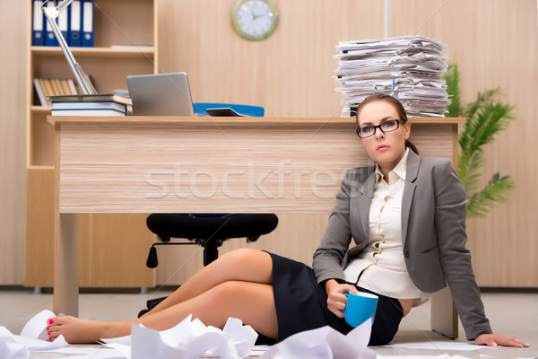 Businesswoman under stress from too much work in the office Stock photo © Elnur