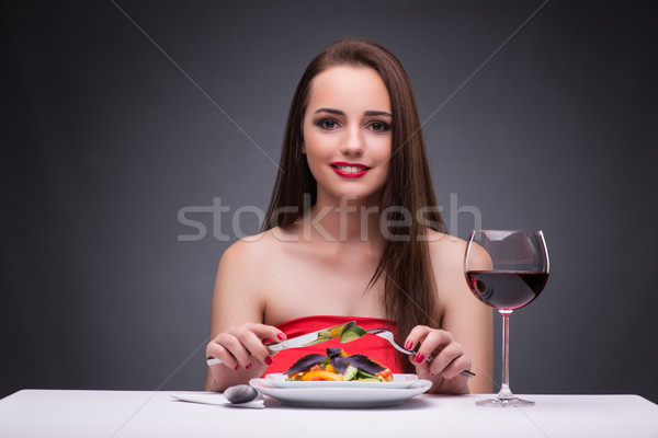 Beautiful woman eating alone with wine Stock photo © Elnur