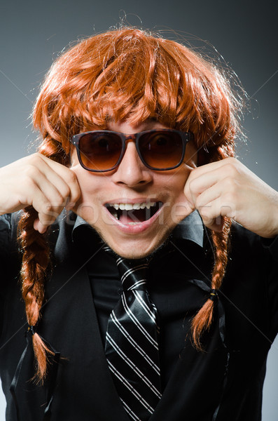 Funny man with red hair wig Stock photo © Elnur