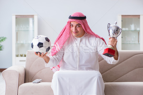 The arab man watching sport football at tv Stock photo © Elnur