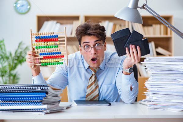 The funny accountant bookkeeper working in the office Stock photo © Elnur