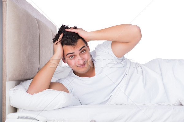 Stock photo: Man in bed suffering from insomnia