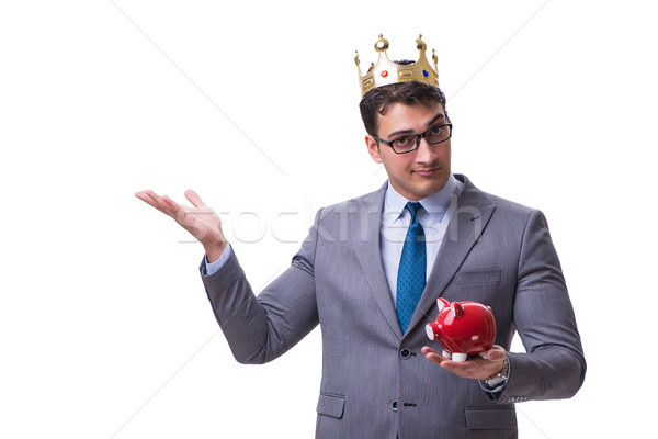 King businessman holding a piggy bank isolated on white backgrou Stock photo © Elnur