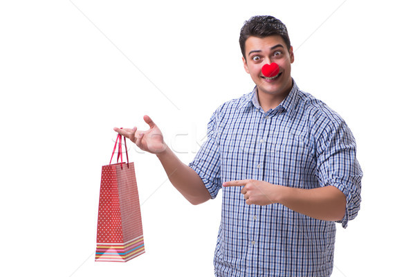 Man with a red nose funny holding a shopping bag gift present is Stock photo © Elnur