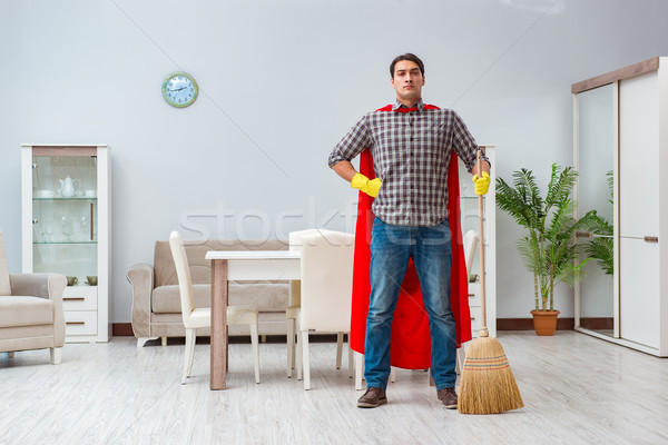 Stock photo: Super hero cleaner working at home